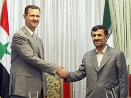 Syrian President Bashar al-Assad (L) shakes hands with Iranian President Mahmoud Ahmadinejad (R) after a joint press conference in Tehran